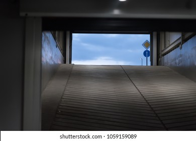 Tunnel of underground parking. Blue sky at the end of the exit. the concept of a way out of a difficult situation