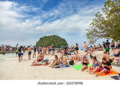 TUP ISLAND, THAILAND - JANUARY 05, 2015: Small island crowded with tourists. Picture presents unsustainable and unregulated tourism development by small private companies in Thailand.