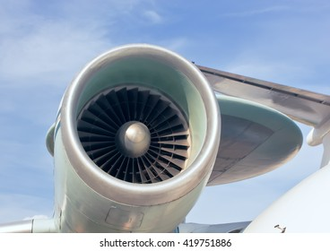 Turbine aircraft engine blades and against a background of clouds. Jet engine