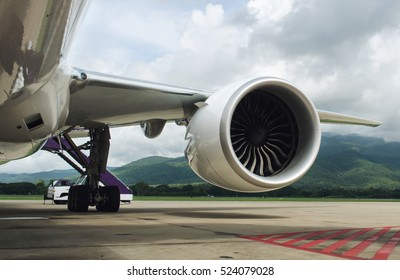 Turbine of engine airplane in airport background.