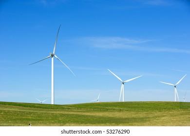 A turbine in a field at wind farm