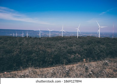 turbine having a large vaned wheel rotated by the wind to generate electricity.