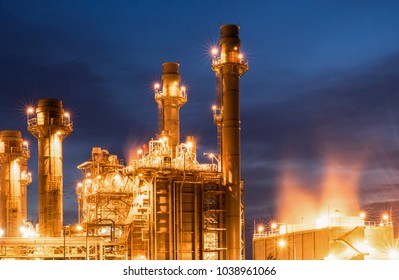 turbine tubeof oil factory, petrochemical plant in twilight with colorful sky.