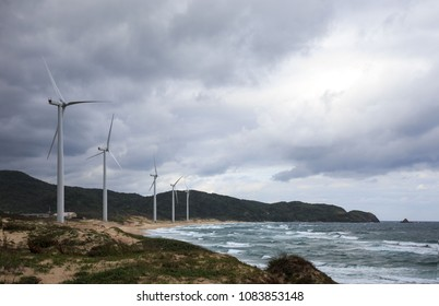 Turbines harnessing wind power along the Sea of Japan