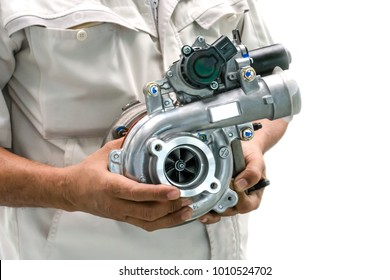 Turbocharged intelligent car variants in the hands of a car mechanic on a white background.