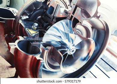 Turbocharger structure illustration with cross section, colorful toned photo with soft selective focus