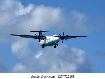 Turboprop passenger airplane in flight approaching for landing