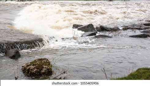 Turbulent flood waters and an exposed rock