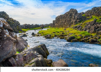 Turbulent flow downstream from a waterfall in Thingvellir National Park in Iceland