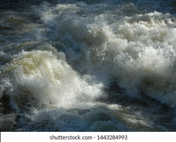 Turbulent stream of foamed water and water spray, stroma, waterfall