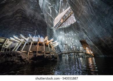 Turda, Romania - July 8, 2016: Underground lake in Salina Turda salt mine in Turda city