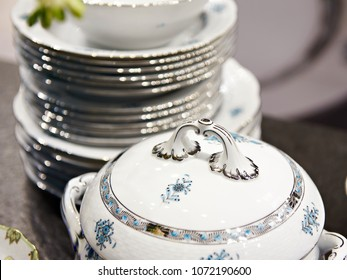 Tureen and a stack of plates