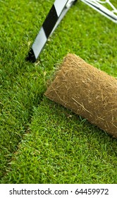 Turf grass roll partially unrolled on sport field - closeup