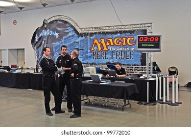 TURIN - APRIL 1: Main table with some unidentified judges of Magic The Gathering, a fantasy card game, during the tournament Grand Prix Turin on April 1, 2012 Turin, Italy.