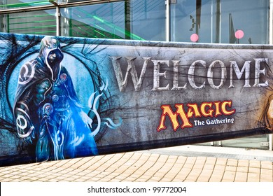 TURIN - APRIL 1: The welcome poster of Magic The Gathering at the main gate of the site of the tournament Grand Prix Turin on April 1, 2012 Turin, Italy.