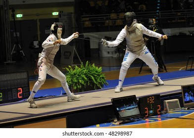 TURIN, FEB 6: Women Foil World Cup, Korean fencer NAM Hyun Hee fight against Italian fencer DURANDO Benedetta during semifinal match on  February 6, 2010 in Turin, Italy.