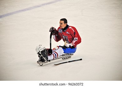 """TURIN - FEBRUARY 25: Energy break of unidentified Czech player during qualification's match Italy Vs Czech Republic. Ice Sledge Hockey tournament """"Città di Torino"""" on February 25, 2012 Turin, Italy."""
