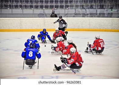 """TURIN - FEBRUARY 25: Faceoff between Italy and Czech Republic teams during qualification's phase of Ice Sledge Hockey tournament """"Città di Torino"""" on February 25, 2012 Turin, Italy."""