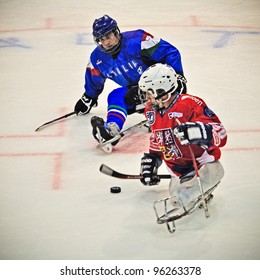 """TURIN - FEBRUARY 25: Unidentified players during qualification's match between Italy and Czech Republic. Ice Sledge Hockey tournament """"Città di Torino"""" on February 25, 2012 Turin, Italy."""