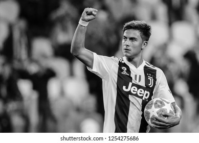 Turin, Italy, 02 October 2018. UEFA Champions League, Juventus vs Young Boys 3-0. Paulo Dybala, Juventus, with the ball for the three goal scored, celebrate the victory.