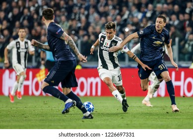 Turin, Italy. 07 November 2018. UEFA Champions League, Juventus vs Manchester United 1-2. Paulo Dybala, Juventus, and Nemanja Matic, Manchester United, vie for the ball.