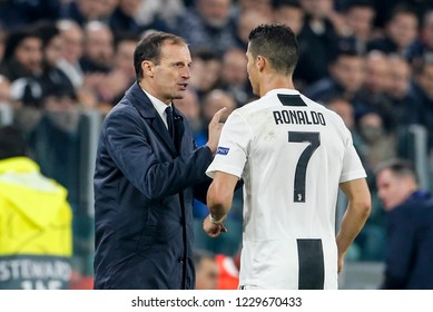 Turin, Italy. 07 November 2018. UEFA Champions League, Juventus vs Manchester United 1-2. Massimiliano Allegri, coach Juventus, talks to Cristiano Ronaldo.