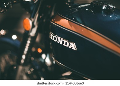 Turin/ Italy - 07/28/2018: Tank of a Honda blue motorcycle with yellow stripes, focusing on the Honda house logo