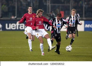 "Turin Italy ,12 March  2003, ""Delle Alpi"" Stadium, UEFA Champions League 2002/2003, FC Juventus- FC Manchester United: David Beckham and Antonio Conte in action during the match"