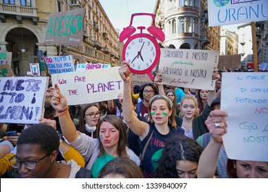 Turin, Italy - 15 march 2019 Protestors with banners at a Youth strike for climate march Friday for Future