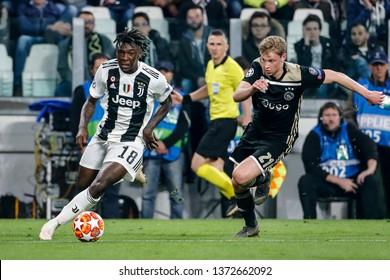 Turin, Italy. 16 April 2019. UEFA Champions League, Juventus vs Ajax 1-2. Moise Kean, Juventus, and Frenkie de Jong, Ajax, vie for the ball.