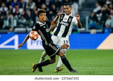 Turin, Italy. 16 April 2019. UEFA Champions League, Juventus vs Ajax 1-2. Alex Sandro, Juventus, and David Neres, Ajax, vie for the ball.