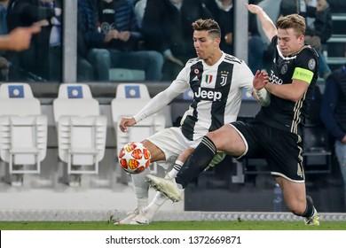 Turin, Italy. 16 April 2019. UEFA Champions League, Juventus vs Ajax 1-2. Cristiano Ronaldo, Juventus, and Matthijs de Ligt, Ajax, vie for the ball.