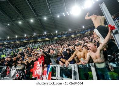 Turin, Italy. 16 April 2019. UEFA Champions League, Juventus vs Ajax 1-2. Supporters of Ajax celebrating.