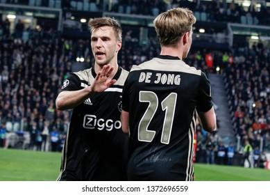 Turin, Italy. 16 April 2019. UEFA Champions League, Juventus vs Ajax 1-2. Joel Veltman and Frenkie de Jong, Ajax, celebrating.