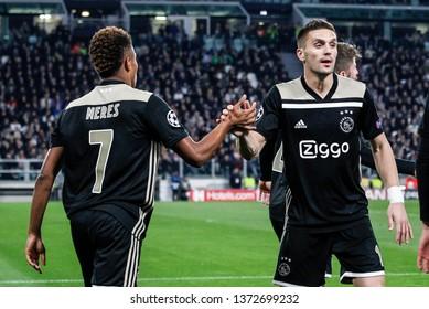 Turin, Italy. 16 April 2019. UEFA Champions League, Juventus vs Ajax 1-2. David Neres and Dusan Tadic, Ajax, celebrating the goal.