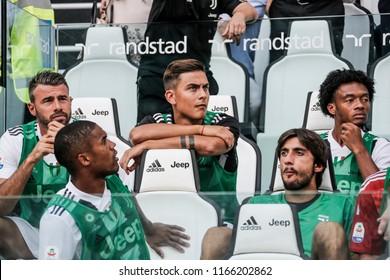Turin, Italy. 25 August 2018. Campionato Italiano di SerieA, Juventus vs Lazio 2-0. Paulo Dybala, and team mates of Juventus, sitting on the bench.