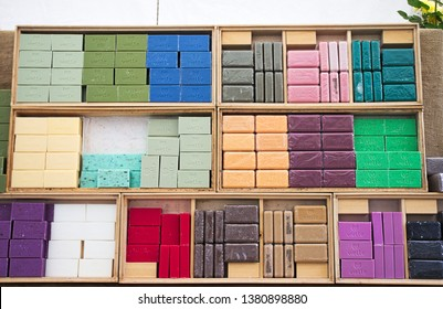 Turin, Italy - April 12, 2019: Handicraft multicolored soap bars on display in a craft market