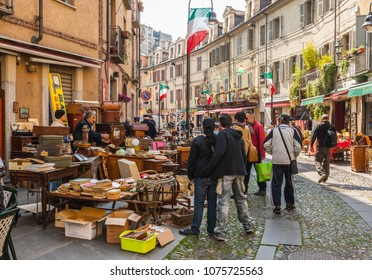 """Turin, Italy - April 16, 2011: Tourists visiting the """"Balon"""", the typical flea market of Turin. It is located near the market of Porta Palazzo, the largest open-air market in Europe."""