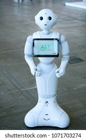 """Turin, Italy - April 2018: """"Pepper"""" robot assistant with information screen in duty to give information"""