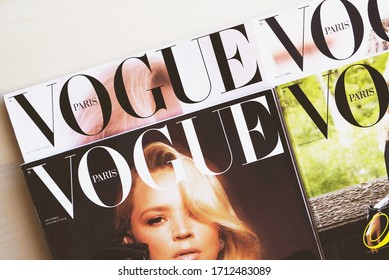 Turin, Italy - April 2019: Heap of Vogue Paris magazines, french edition of Vogue magazine.