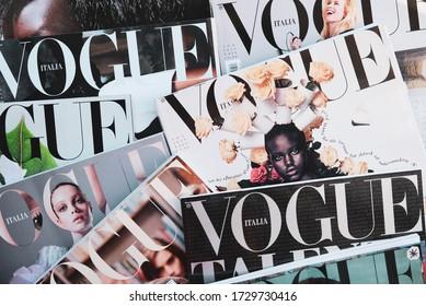 Turin, Italy - April 2020: Heap of Vogue Italia magazines, Italian edition of Vogue magazine, the top fashion magazine in the world.