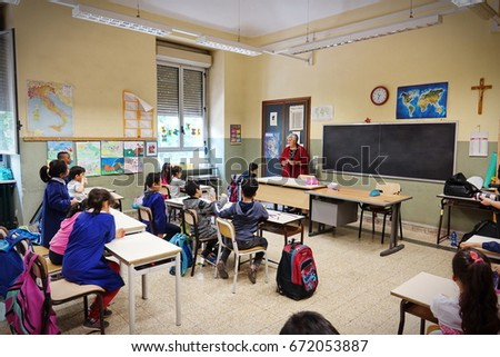 Turin, Italy - April 4, 2017: Children during the school activity in the multi ethnic school of Porta Palazzo