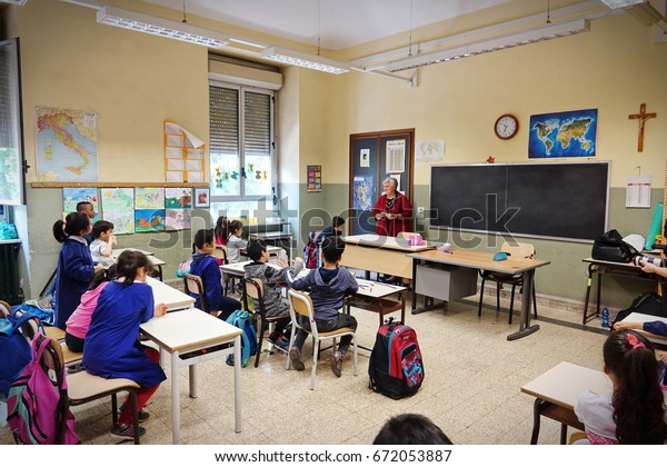 Turin, Italy - April 4, 2017: Children during the school activity in the multi ethnic school.