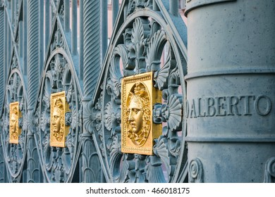 TURIN, ITALY - August 08, 2016: Royal Palace Turin, Residences of the Royal House of Savoy - Heads of Medusa, gold color, detail of the railings - Turin, Piazzetta Reale 1 - World Heritage site 1997