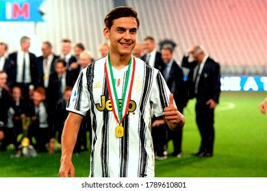 TURIN, ITALY - August 1, 2020:  Paulo Dybala celebrates with the trophy during the award ceremony for Serie A 2019-2020 title (scudetto) during the Serie A 2019/2020 JUVENTUS v ROMA at Allianz Stadium