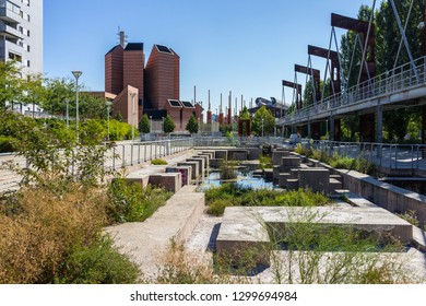 Turin, Italy - August 27, 2018: Parco Dora, a public park built on a former industrial area, preserving some structures of the old plants.