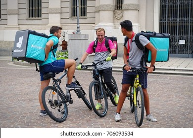 Turin, Italy - August 30, 2017:  bicycle riders of home delivery food at work