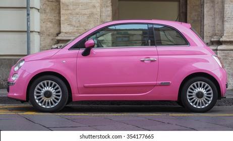 TURIN, ITALY - CIRCA DECEMBER 2015: Pink Fiat 500 car new model