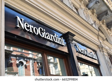TURIN, ITALY, CIRCA JUNE 2017: the shop window of Nero Giardini (Black Gardens) a shoes, accessories and clothing Italian brand, in an ancient marble building.