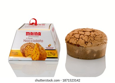 TURIN, ITALY - DECEMBER 10, 2020: box packaging and  panettone gran nocciolato Maina isolated on white background